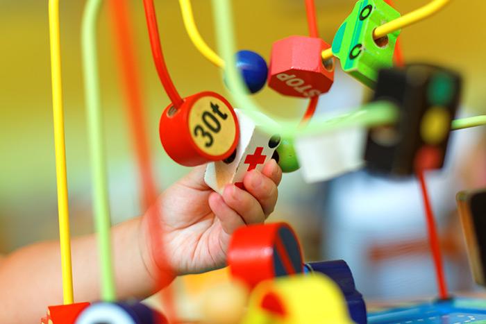 hand of child playing in kids development center